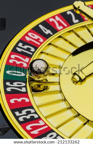 the cylinder of a roulette gambling in a casino. winning or losing is decided by chance. number zero, lost everything - stock photo