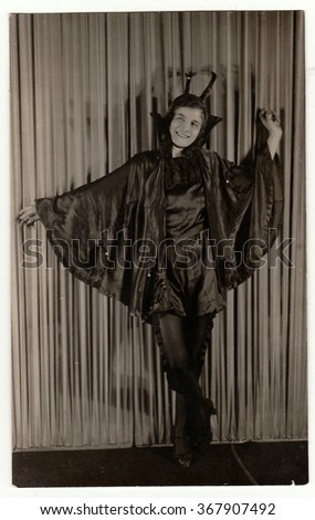 THE CZECHOSLOVAK REPUBLIC, CIRCA 1930s:  Vintage portrait photo shows young girl in a retro carnival costum (devil costum). Photo studio portrait, circa 1930s. - stock photo