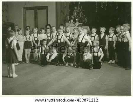 THE CZECHOSLOVAK SOCIALIST REPUBLIC - CIRCA 1960s: Retro photo shows small pupils in the classroom. Schoolmates participate in school performance during Christmas time.  Vintage black & white photo.