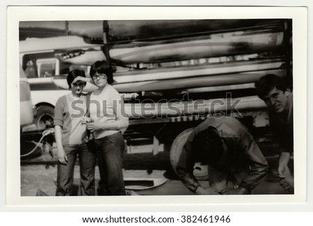 THE CZECHOSLOVAK SOCIALIST REPUBLIC - CIRCA 1980s: Vintage photo shows young canoeists prepare to canoeing.