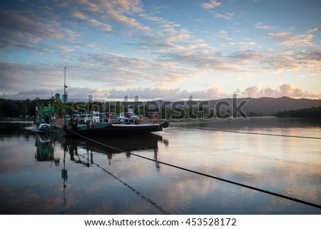 The Daintree River ferry crossing at sunset near the ferry crossing in far nth Queensland, Australia - stock photo