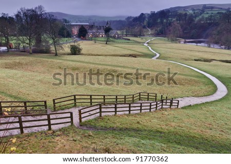 The Dales Way footpath as it winds its way serenely past Bolton Abbey in the Yorkshire Dales towards Windermere in the Lake District - colour, deserted footpath - stock photo