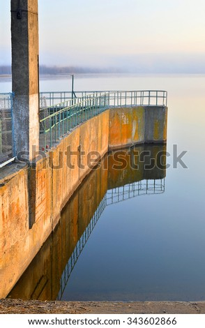 The dam reservoir on the river - stock photo