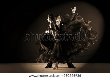 The dancers in ballroom isolated on black - stock photo