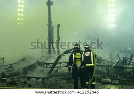 the dangerous task of  firefighters - stock photo