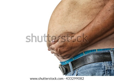 The Dangers of Belly Fat., Obese Man in Jeans Squeeze the Belly Fat - stock photo