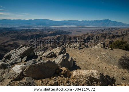 The Dante View is the best high view of the Death Valley. You can see various landscape; mountain covered by snow, salt flat, and desert. It has a steep road to get here and a rocky trail. - stock photo