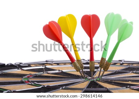 the darts hit the target on dartboard - stock photo