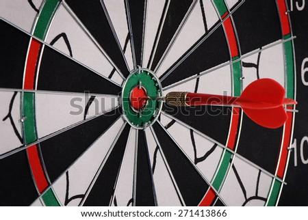 The darts on a black background. Macro - stock photo