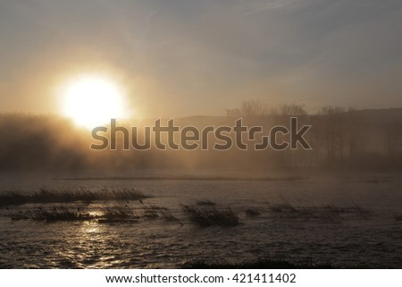the dawn on the river at summer - stock photo