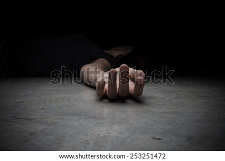The dead woman's body. Focus on hand - stock photo
