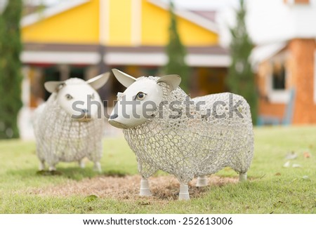 The decorative sheep dolls in garden   - stock photo