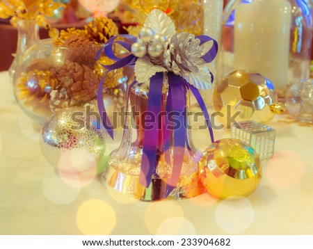 The decorative silver christmas bell adorn and christmas ball with defocused bokeh lights. : filtered process - stock photo