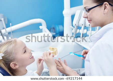 The dentist and child in the dental office - stock photo