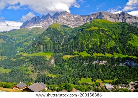 The Dents du Midi mountain range, above the village of Champery, Canton Valais, Switzerland - stock photo