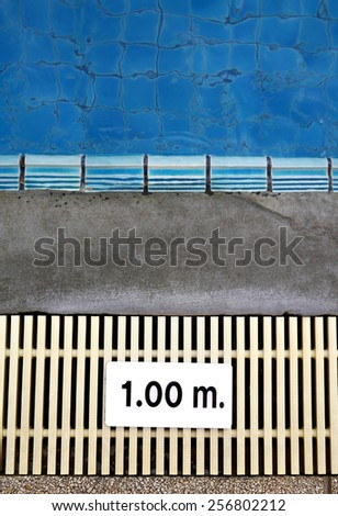 The depth of the water in SWIMMING POOL - stock photo