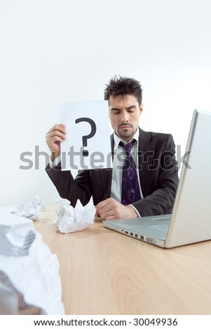 The despaired clerk has problems thinking about question - stock photo