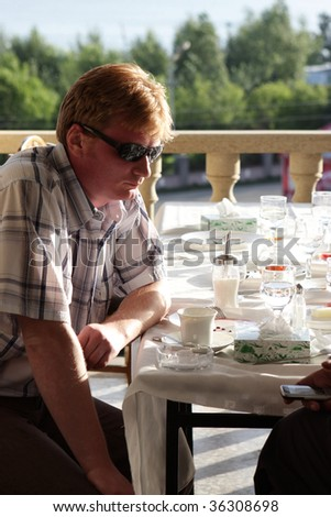 The despondent man in outdoor cafe in Armenia - stock photo