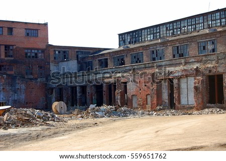The destruction of the old factory building.
