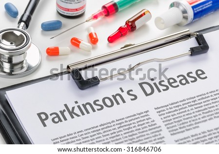 The diagnosis Parkinsons Disease written on a clipboard - stock photo