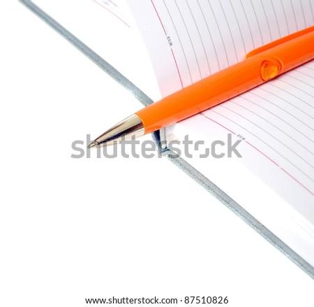 The diary and orange pen - stock photo