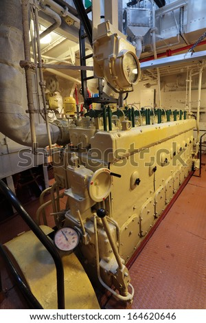 The diesel engine in the hold of the old ship - stock photo