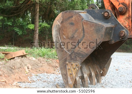 The digging blade of a front end loader - stock photo