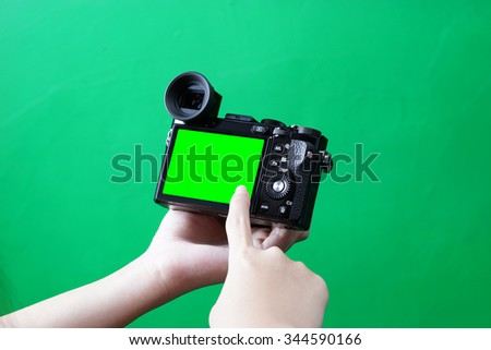 The digital camera in hand - stock photo