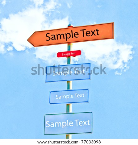 The Direction signs isolated on sky background - stock photo
