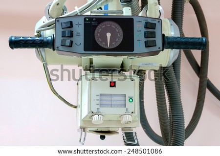 The directional pad older X-ray machines by hand. - stock photo