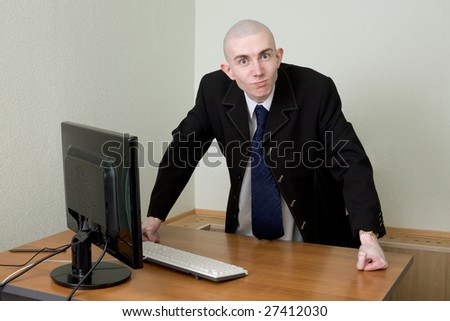 The director in a jacket and a tie at office - stock photo
