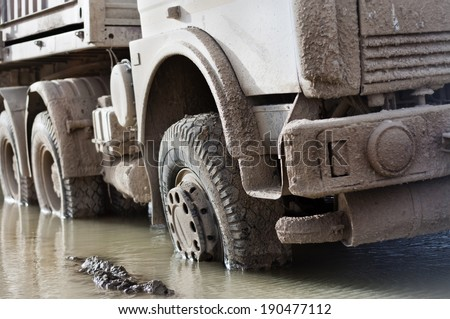 The dirty truck which got stuck in the mud - stock photo