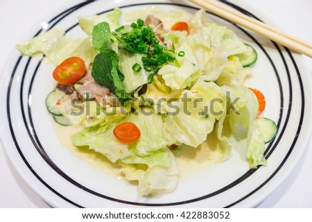 The dish of Spicy Salmon Salad - stock photo