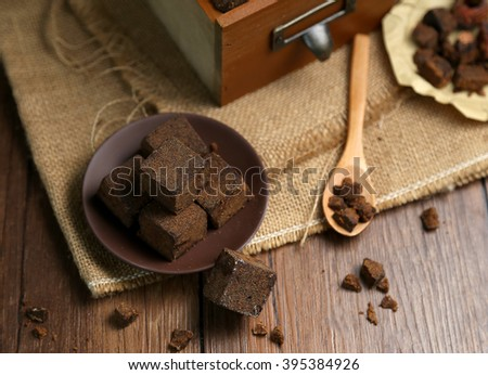 The dishes in the box and block of brown sugar