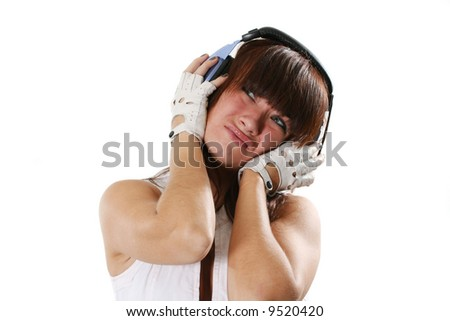 The dissatisfied girl listens to music in headphones