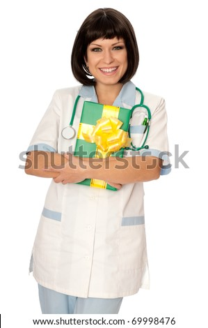 The doctor holding a gift from patient in the hand