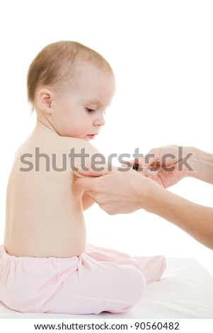 The doctor makes a baby vaccination on a white background. - stock photo