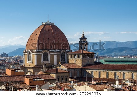 The dome of the Cappella dei Principi dominates the San Lorenzo architectural complex (Medici Chapels). Aerial view from Giotto's Campanile. Florence, Tuscany, Italy. - stock photo