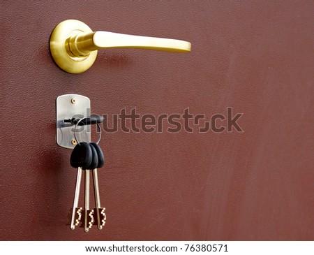 The door handle with keys - stock photo