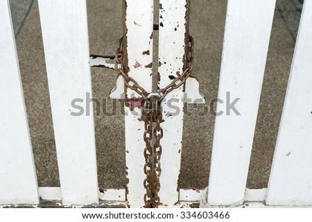 the door with chain padlock  - stock photo