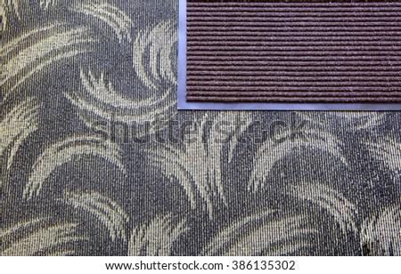 The doormat isolated on carpet background - stock photo