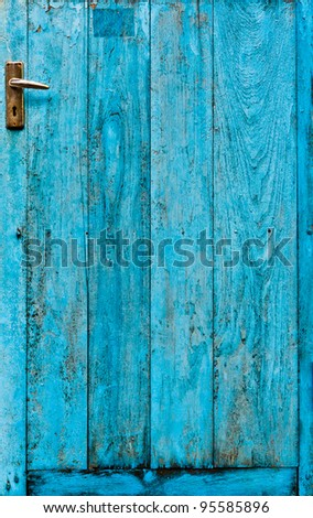 The doors made of wood painted blue - stock photo
