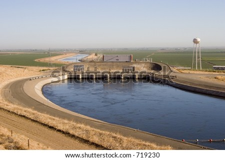 "The ""Dos Amigos"" pumping plant pushes water up hill on the San Luis Canal, part of the California Aqueduct system. - stock photo"