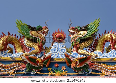 The Double Chinese dragon on the temple roof. - stock photo