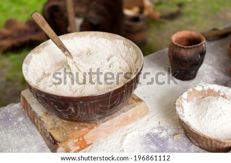 The dough for baking pies ancient bread - historic vessels - stock photo