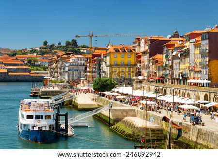 The Douro River and Colorful facades of old houses on embankment in Porto, Portugal. Porto is one of the most popular tourist destinations in Europe
