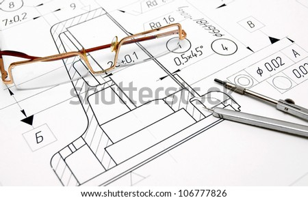 The drawing, glasses and compasses . - stock photo