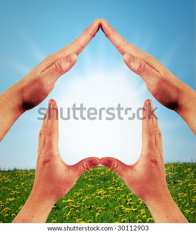 The Dream of an own house showed by hands - stock photo