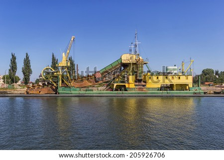 The dredger moored in harbor to coastal - stock photo