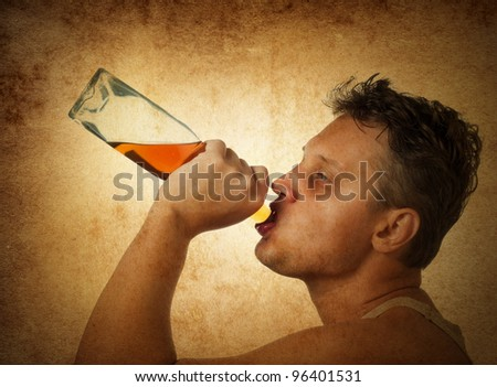 The drinking man on grange background. Concept. - stock photo